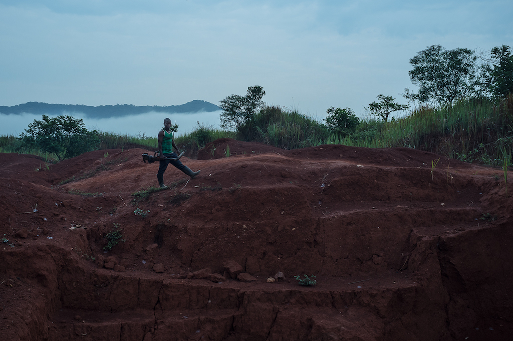 Miner with a metal detector near the Kamoko gold mine in DRC